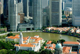 Modern business district and colonial Boat Quay, Singapore poster