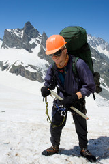 Happy climber in helmet and crampon