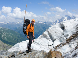 mountain-climber in high mountains with glacier at background