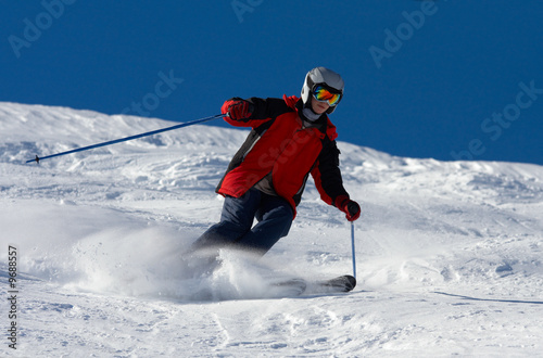 Skier in helmet rush at full speed
