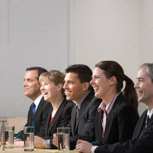 Panel of co-workers laughing