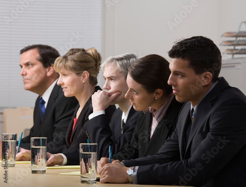 Panel of co-workers conducting a job interview