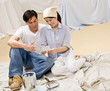 Couple sitting with color swatch preparing to decorate home
