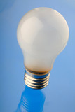 electric lamp of white color on  blue background, close up