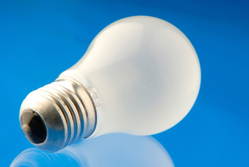 electric lamp of white color on  blue background