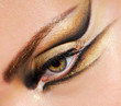 Close-up woman's eye with multicolored stylish make-up