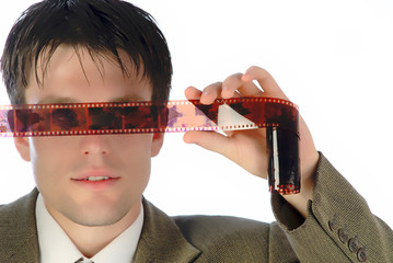 young businessman considers  film,  close up