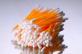 hygienic sticks of orange color on  white background poster