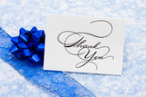 Thank you card with ribbon and bow on blue snowflake
