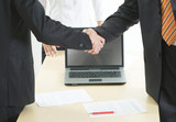 Image of great business handshake over workplace poster