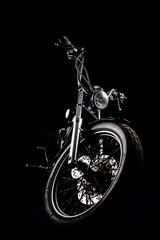 Chopper motorcycle front isolated on black © drx