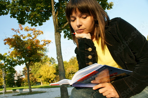 Cute girl reading a book