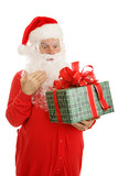 Santa Claus in his pajamas, surprised by a Christmas gift. poster