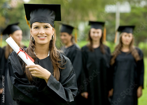 graduation group of students with a woman leading smiling