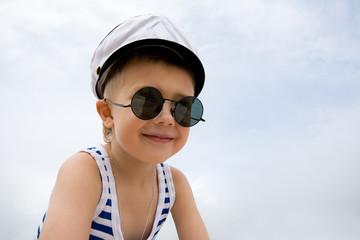 Ship's little boy.Cap.Sunglasses