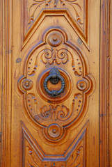 View of a doorknocker in a wooden door