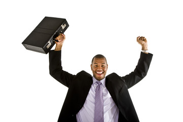 A black man in a business suit raising his briefcase and fist