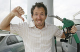 Man happy about decreasing petrol prices poster