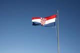 Croatian flag floating on a blue sky poster