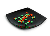 expensive chemical diet - colored pills on black asian plate poster