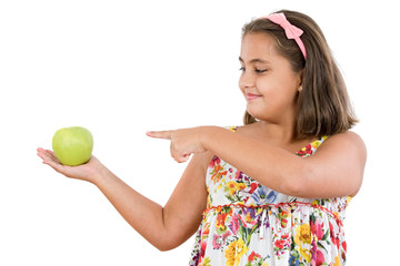 Adorable girl with a apple on a white background
