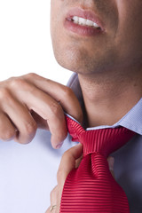 businessman adjusting his necktie in a day of great stress