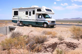 Motorhome RV with Flat in Desert poster