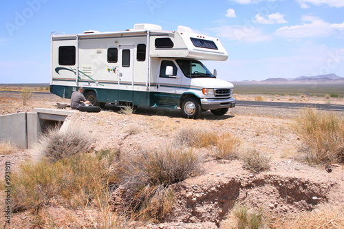 Motorhome RV with Flat in Desert - 9731911