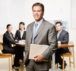 Businessman with notebook and co-workers in conference room