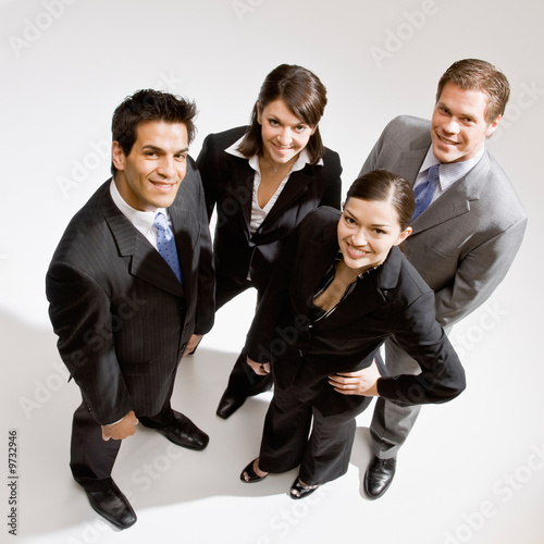 Confident co-workers standing in group