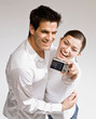 Happy couple taking self-portrait with digital camera