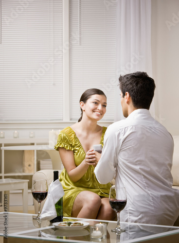 Man romantically proposing to surprised girlfriend