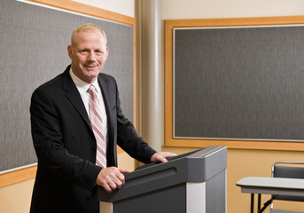 Businessman standing behind podium
