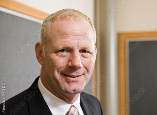 Close up of mature businessman in suit and tie