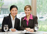 Confident businesswomen posing in conference room