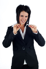 Business woman breaking a cigarette