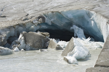 Ice falls into a stream from the Athabasca Glacier.