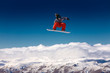 Snowboarder in the air with deep blue sky in background