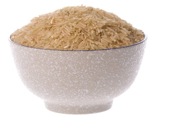 Isolated image of brown rice in a bowl.