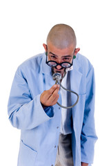 Nutty doctor watching his stethoscope with funny spectacles