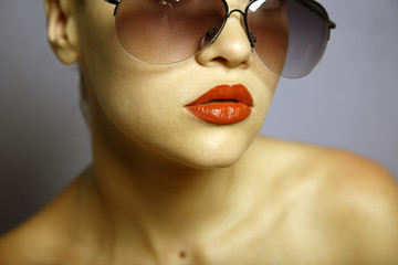 Fashion portrait of young pretty woman with glasses