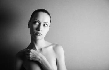 Black & white portrait of nude elegant girl. Studio photo.