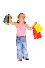 Extremely happy little girl with shopping bags - isolated