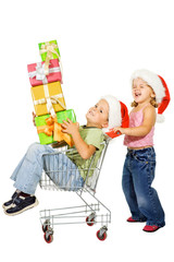 Kids with shopping cart and christmas presents - isolated