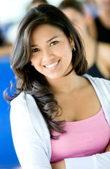 beautiful woman at the gym portrait smiling at the camera