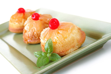 Mini Pineapple upsdie down cakes isolated on white