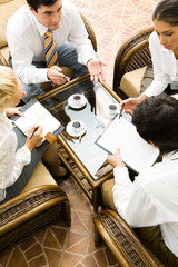 Vertical image of people interacting together at meeting