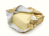 Butter in gold foil isolated on white background
