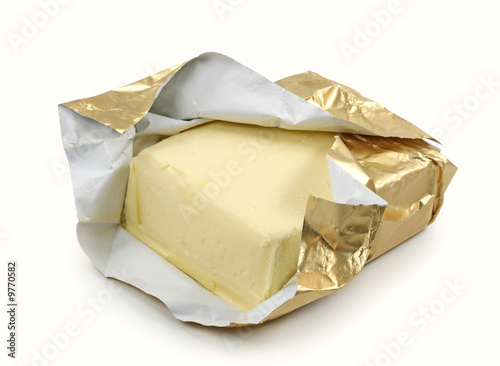 Butter in gold foil isolated on white background - 9770582
