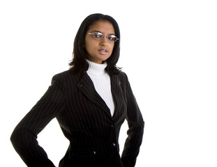 A beautiful businesswoman in a grey suit and glasses